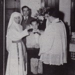 SFX old photo - Sr Leonard baptizing a patient in hospital with Sr Fung